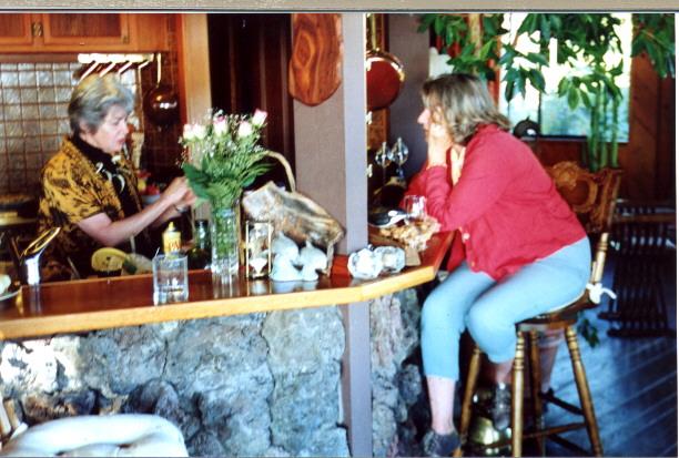Marilyn & Ann at kitchen bar.